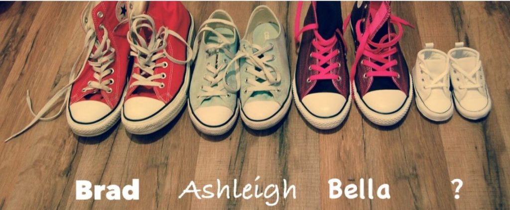 Pregnancy announcement using Converse shoes to represent all members of the family.